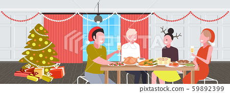 friends sitting at table having christmas dinner merry xmas happy new year winter holidays 59892399