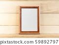 Vertical wooden mockup frames on a light 59892797