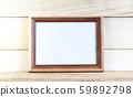 Horizontal wooden mockup frames on a light 59892798