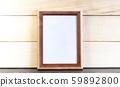 Vertical Dark Brown Picture Frame on Wooden Planks 59892800