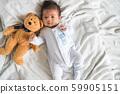 Cute little boy lying on soft blanket 59905151