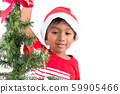 Cute little boy with decorating Christmas tree 59905466