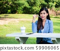 smile face asia business woman sitting garden with 59906065