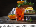 Traditional italian cocktail with wine and orange 59906088