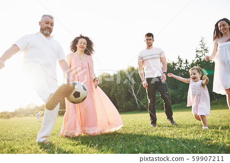 Relax with the whole family. Several gender generations came together for a walk in the park 59907211