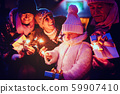 Family visiting the Christmas market 59907410