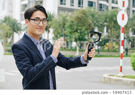 Smiling man with monopod 59907413