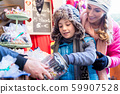Mother and son on Christmas market getting sweets 59907528