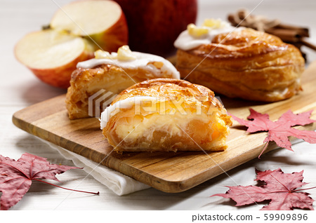 piece of cinnamon apple pie on a wooden board with 59909896
