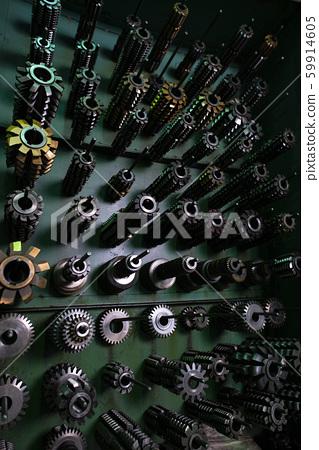 Metal blanks hanging in order on hooks view 59914605