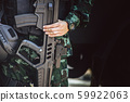Infantry army soldier hand holding machine gun for security guard standing 59922063