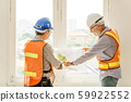 Happy professional worker working together home builder architecture mix race in construction site 59922552