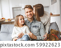 Family at home together leisure love concept kiss 59922623