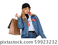Stylish teenager girl with shopping bags and sales labels on denim wear 59923232