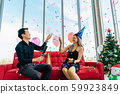 Happy Asian couple celebrating Christmas together 59923849