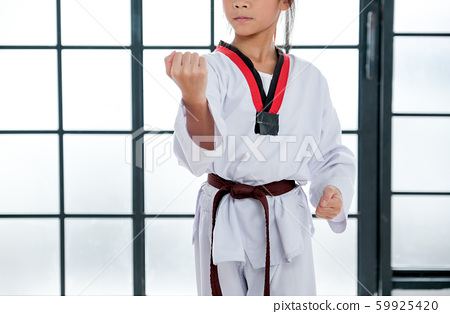Close up shot of young taekwondo student shows different postures 59925420