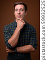 Young handsome man against brown background 59932525