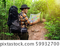 man traveler with backpack and map searching 59932700