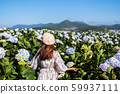 Young woman traveler enjoying with blooming 59937111