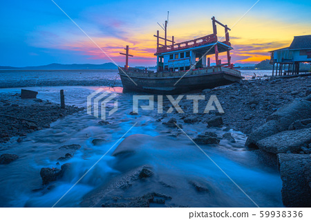 shipwreck beside the canal in sunset 59938336