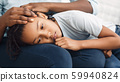Close-up of black girl's head laying on lap 59940824