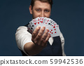 Man holding showing poker cards on blue background 59942536
