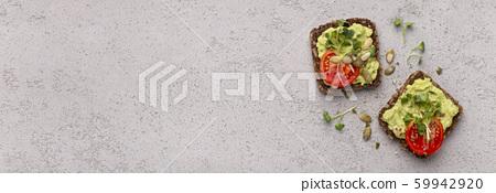 Rye bread vegetarian sandwiches with fresh avocado spread 59942920