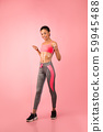 Sporty Black Woman Holding Jump Rope Exercising Over Pink Background 59945488