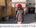 Attractive slim dark-haired girl in red beret and 59947736