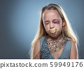 Sad and frightened little girl with bloodshot and bruised eyes, fiction of happiness 59949176