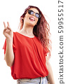 Redhead girl with tongue out and peace sign 59955517