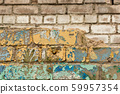 Crumbling brick wall of dismantled building 59957354