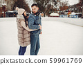Cute couple in a ice arena 59961769
