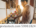 Happy african-american couple cooking dinner in kitchen 59961824