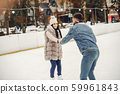Cute couple in a ice arena 59961843