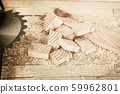 pieces of wood with saw blade on the boards background 59962801