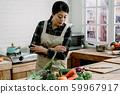 housewife preparing tasty salad in kitchen 59967917