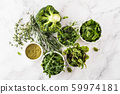 Fresh green vegetables variety on white background from overhead, broccoli, thyme, rosemary, spinach, microgreens. 59974181