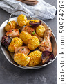 Roasted chicken leg with potatoes cumin and garlic on black background. Copy space. 59974269