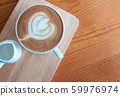 Latte coffee cup with latte art on wooden table in 59976974