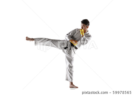 Confident korean man in kimono practicing hand-to-hand combat, martial arts 59978565