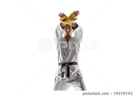 Confident korean man in kimono practicing hand-to-hand combat, martial arts 59978593