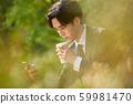 Businessman teatime smartphone 59981470