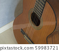 close up body of spanish acoustic guitar focused 59983721