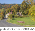 road to the village chapel in autumn rural 59984565