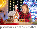 Kids baking gingerbread house. Christmas at home. 59985021