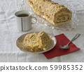 sliced caramel swiss roll on plate with walnuts 59985352