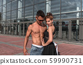 Young couple girl man dancer posing, dance glass windows background, summer city, hip hop style, break dancer. Free space motivation text. Active youth lifestyle, modern fashionable, couple dancer. 59990731