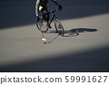 Man plays urban bike polo. Cyclist hits the ball with a bundy, close up. Sport lifestyle concept 59991627