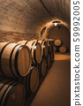 Old wine barrels in the vault of winery 59992005